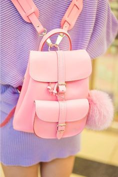 Pink pom pom backpack by Grafea.