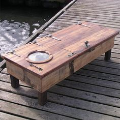 door salvaged from an old fishing boat  into a storage coffee table