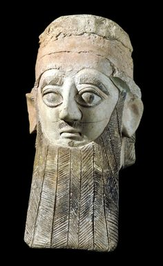 Head of a large terracotta statue of a bearded man, probably a worshiper. Cypro-Archaic. 650 - 600 B.C. | The British Museum