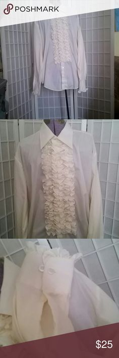 Vintage Ruffle button down shirt Made for men, but I rocked this tied at the waist throughout high school.  Three rows of ruffles, ruffle cuffs and starched collar  26inches shoulder seam to edge of cuff, 30inch shoulder to hem, 42inch top, and 17.5inch neck  Sized xl After Six Shirts Dress Shirts
