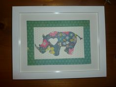 Rhino silhouette picture made from fab patterned paper.