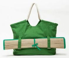 Classic canvas summertime beach tote with a role up beach mat. Features snap closure, full lining, soft rope handles, and two interior pockets. Canvas beach tote Soft rope handles Fully lined Rolled up beach matt with straps Yoga Mat Bag, Diy Purse, Beach Tote Bags, Fabric Bags, Summer Bags, Cloth Bags, Handmade Bags, Purses And Bags, Fashion Trends