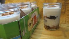 Maple cream line parfaits with granola and winter fruit compote ready To Go to a table near you in mason jars.