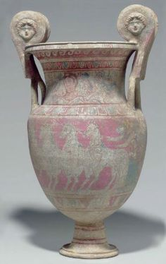 Canosan polichromed pottery volute krater, Apulia, early 3rd century B.C. One side with a winged Nike driving a quadriga to the left  on a pink ground, the neck with a female head in three quarter view amidst florals, bands of ovolo and wave above, the other side with fully armed warriors in combat, 60 cm high. Private collection