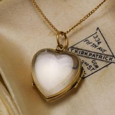 This Victorian locket is composed of two heart-shaped quartz panels fitted in 9k gold. The rock crystal acts as a magnifying glass and will ever-so-slightly visually amplify the perceived size of the photo or paper memento placed inside. Hangs from a 15