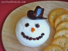 Snowman Cream Cheese Ball Recipe: She just used a pack of plain cream cheese, but you could season this anyway you wanted, then add a layer of plain cream cheese on top of any flavor.  @Cute Food For Kids: Snowman Cream Cheese Ball