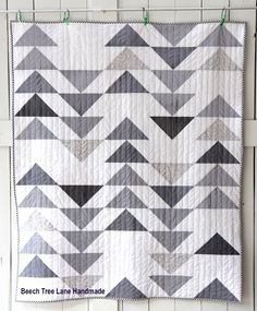 What a fun quilt this one was to sew. Before I knew it, I was doing the binding. For this quilt, I wanted a modern, clean geometric kind of look. So I made Half Square Triangles and did a Flying…
