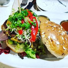 The impossible burger - delicious! With roasted bell peppers onions shallots and a ginger lemon vinaigrette. And no animal was harmed in the making of it.  Totally recommend it!  #impossibleburger #eatplants #onmyplate