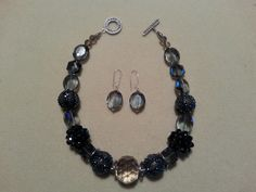Elegance with volume and depth!--This set offers shades of darker blues with crystal.  Slightly longer than a choker, the necklace is a statement piece and then just toss in the beautiful matching earrings.