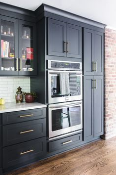 White Shaker cabinets with white countertops and black pantry. White Shaker cabinets with white countertops and black pantry. - Own Kitchen Pantry Kitchen Pantry Design, Kitchen Pantry Cabinets, Kitchen Ideas, Kitchen Decor, Kitchen Organization, Kitchen Designs, Diy Kitchen, Kitchen Counters, Kitchen Islands