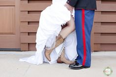 dress blues and cowboy boots! Just like my wedding ;)