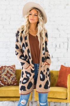 """We love a good cardigan, and our new Claudia Leopard Print Cardigan does not disappoint! Our cardigan features a longer length, a trendy leopard print, a colored stripe around the cuff and hem and with pockets. This piece is perfect for every woman's wardrobe. It is so soft and has a semi-loose fit as well as a great quality fabric. Wear it over all your tanks and tees this season and you're sure to look and feel great! Model Info: Models are 5'7"""", Size 2, wearing smalls Body Length Measures… Best Cardigans, Leopard Print Cardigan, Feeling Great, Every Woman, Loose Fit, Fashion Boutique, Tanks, Size 2, That Look"""