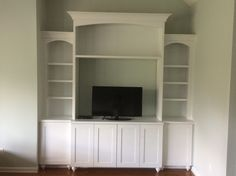 Finished entertainment unit by Woods Cabinets, LLC. The details on the top and the cabinets give this unit a more interesting twist on the traditional style. Custom Shelving, Shelving Units, Entertainment Centers, Wood Cabinets, Built Ins, Bookshelves, Woods, The Unit, Entertaining