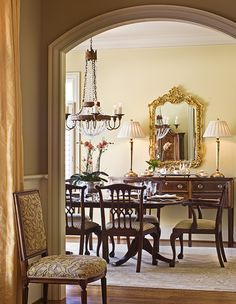 Beautiful Dining Room With Gold Accents.