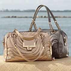 Swirled Quilted Satchel from Monroe and Main. Swirling, quilted metallic detail.