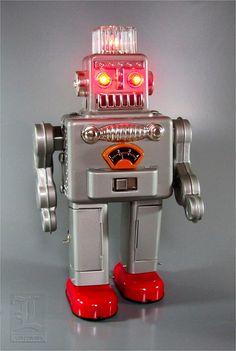 The robot walks forward with the multi-colored lights in its plastic dome spinning around. It stops, and while its eyes light up, it breathes out puffs of smoke! Vintage Robots, Retro Robot, Retro Toys, Vintage Toys, Robot Cute, I Robot, Atomic Decor, Magnetic Drawing Board, Robot Monster