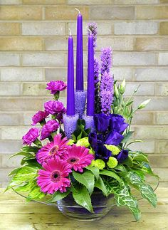Gerberas  ,carnations , + purple candles