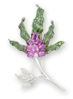 A gem-set brooch designed as a flower, set at the centre with yellow sapphires, within pink sapphire petals, to a brilliant-cut diamond stem and tsavorite garnet and yellow sapphire leaves, mounted in 18k blackened, white and yellow gold.