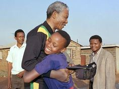 South African National Congress President Nelson Mandela hugs, October a young Sowetan girl as he visits the black township near Johannesburg. Nelson Mandela Day, African National Congress, Mandela Quotes, First Black President, Human Rights Activists, Black Presidents, African American History, My People, Civil Rights