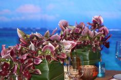 Hawaiian hula dinner party with hundreds of lady slipper orchids. Designed by Ornamento!
