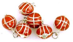 *Cast in bright silver, these have a 3D affect to them with the enamel color of a basketball. Very cute little guys! Each comes with a split ring at the top. No. of holes per side: 1 Hole location and