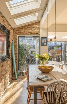 Home renovation | kitchen extension | family room | sloped roof | folding doors | internal brick wall | feature surfboard | parquet flooring | open plan | architectural photography | interior photography | architecture | interior design | howard baker photography