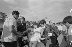101 Tragedies of Enrique Metinides Red Cross workers take a young woman, who was on her way to a party, from the scene of a crash.