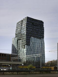 Completed in 2009 in Amsterdam, The Netherlands. Images by Christian Richters. The Erick van Egeraat office tower, also known as The Rock, is part of an expressive high- rise urban development south of Amsterdam, named Zuidas. Unique Buildings, Interesting Buildings, Amazing Buildings, Beautiful Architecture, Contemporary Architecture, Architecture Design, High Rise Building, Rock Design, Building Structure