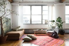 To delineate different areas and their functions, furniture placement is key, setting up mini barriers to the open space without blocking eye lines. Rugs also help demarcate different spaces.