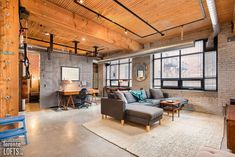 Broadview Lofts - #201 | Toronto LOFTS Exposed Brick Walls, Exposed Concrete, Concrete Floors, Foyer Storage, Toronto Lofts, Lofts For Rent, Fire Doors, Post And Beam, Rooftop Terrace