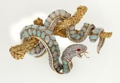 An opal, diamond and ruby brooch, the 14ct white and yellow…