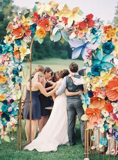 Giant Paper Flower Arch | photography by http://www.ryleehitchnerblog.com/