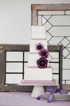 THE ANEMONE CAKE    The hand painted watercolour background on this cake adds a soft and pretty look that highlights the dramatic impact of the sugar anemone flowers.