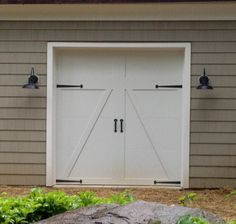 Clopay coachman collection carriage house style garage for Farm style garage doors