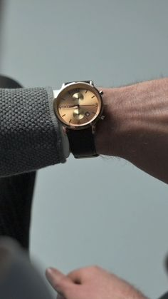 The villainous combination of black and gold sets this Danish design apart from other chronographs… and you don't have to be in a Bond film to wear it. In addition to displaying the time, this watch also includes stopwatch features and a date window. The gold-toned dial includes black embossed dial markers and is enclosed in a durable, polished stainless steel case that complements the gold theme. #trendhim #menswatch #cronographwatch #menstyle #dapper #personalizedwatch #engravedwatch