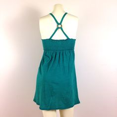 BOGO FREESweet Sundress / Beach Coverup Cute light emerald green babydoll halter-top sundress. F/ front pockets w/ wooden button detail, puckered elastic bodice, & criss-cross back straps w/ wooden O-ring. T-Shirt-like fabric. Great condition; worn once. ♨️Buy One Get One Free offer can be applied to any items in my closet with the BOGO FREE heading. Simply buy one item of higher or equal price, & comment on the other item you want. Both items will be shipped to you.♨️ Licorice Dresses Mini