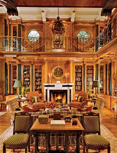 Two story private library #books #library at www.francescocatalano.it.  The only change I would make is putting 4 Navy Blue Lazy Boy Chairs near the fireplace.  That way I could read in style!