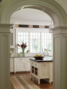 Love the archway and the spotless kitchen