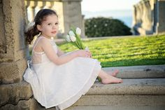 The Emma Elizabeth Lace Flower Girl Dress for toddlers and girls from 2-12 years old, black, peach, white and ivory. $114.95, via Etsy.