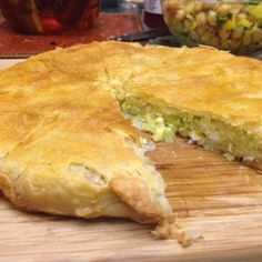 "Russian Cabbage Pie | ""You can bake it as one big pie, or make small triangles called pirozhki. Serve warm."" #recipe #global"