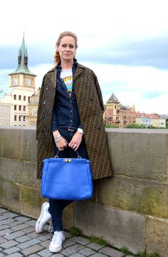 Denim styled with a bold accessory in Prague. (Photo: Devon Kaylor)