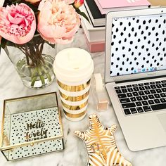 Apple mac laptop, Jonthan Adler Metallic zebra dish, Kate Spade gold striped coffee mug, Kate Spade tape dispenser, Oval marble coffee table, Pink peonies, Target hello lovely jewelry box