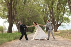 hahahaha dad and groom fighting for the bride!! wedding photo