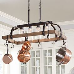 Clear seedy glass adds to the industrial inspired look of this bronze pot rack chandelier. Canopy is 13 wide x 4 deep x 2 high. Includes of chain and wire. Style # at Lamps Plus. Pot Rack Hanging, Hanging Pots, Pot Hooks, Hanging Lights, Home Decor Kitchen, Kitchen Design, Kitchen Ideas, Kitchen Inspiration, Kitchen Chandelier