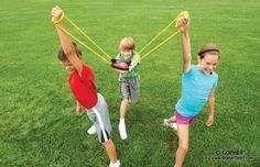 3 kids launching a water balloon