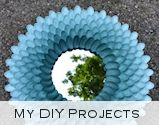 Check out this DYI tutorial on how to make a decorative Chrysanthemum Mirror. Instead of spray painting the white spoons, pick up Dollar Tree's pre-colored options and you can skip a step!