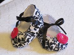 Such cute shoes!  My friend's wife makes these and sells them in her Etsy shop - go to http://www.etsy.com/shop/ewebb131
