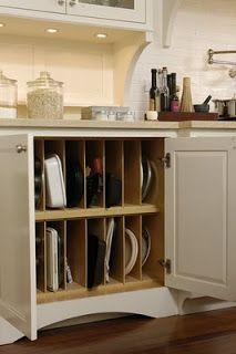This is a brilliant way to store those long, awkward trays, cutting boards, cookie sheets, etc. that don't stack well.