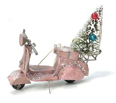 """This fun tin scooter ornament will have you in a bright and cheery holiday mood! - Tin Scooter Ornament with bottle brush tree. - 5"""" long. - Imported."""