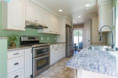 Traditional Kitchen with Hampton Raised Panel Cabinets, Raised panel, Complex granite counters, Salinas White Granite, Galley